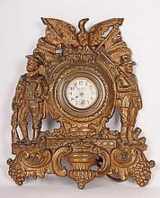 Gilt Metal Spanish-American War Clock Cast iron with original gilt finish, Spanish-American War commemorative easel clock, New Haven Clock Co. face surmounted by spread-winged eagle and crossed American flags, flanked by standing Army soldier and