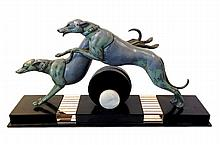 Rochard Rene  Course des Levriers  An Art Deco painted spelter  Course des Levriers group modelled leaping over a fence on onyx base
