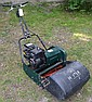 An Ambassador 3hp cylinder lawn mower with grass