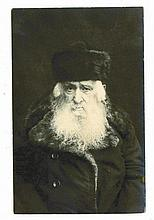 Photograph of Rabbi Yaacov HaLevi Kopstein, Av Beit Din of Nementchin, with a dedication in his handwriting
