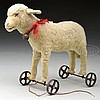 1920s ERA STEIFF LAMB ON WHEELS WITH BUTTON.