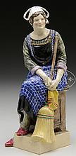 BRITISH STUDIO POTTERY FIGURE OF A PEASANT WOMAN BY JESSAMINE STELLA BRAY AND SYBIL V. WILLIAMS.