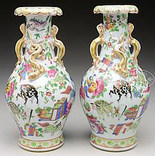 PAIR OF FAMILLE ROSE AND GILT MANDARIN VASES.