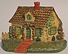EARLY 20TH CENT. PAINTED CAST IRON CAPE COD COTTAGE WITH PICKET FENCE DOOR STOP