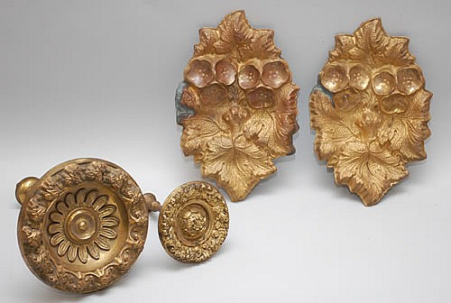 (2) 19TH CENT. EMBOSSED BRASS CURTAIN TIE BACKS & (2) 19TH CENT. CURTAIN ROD MEDALLIONS