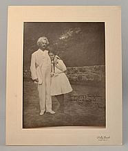 VINTAGE PHOTOGRAPH OF A SIGNED AND PRESENTED PHOTOGRAPH OF SAMUEL CLEMENS (MARK TWAIN) - AFFECTIONALLY HUGGING MISS OGDEN
