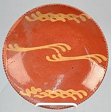 19TH CENT. N.E. SLIP DECORATED REDWARE PLATE
