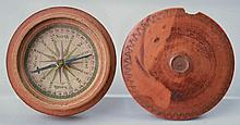 EARLY 19TH CENT. CARVED ROUND WOODEN COMPASS WITH COLORED PAPER DIAL