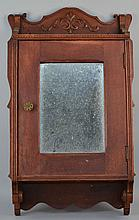 LATE VICTORIAN CARVED OAK AND MIRRORED SHAVING WALL CABINET
