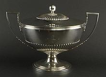 Impressive Large Early 19th Century George III Neo-Classical English Silver Covered Tureen. Ribbed Lower Body and Ribbed Top to Finial. The Handles With Elongated Acanthus Motif. One Side of The Body with Crest