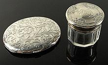 Lot of Two (2) Silver Miniatures. A Chased Silver Folding Traveling Picture Frame. One Side with Glass Insert. Signed LF STERLING. Good Condition. Measures 3 Inches by 2-1/2 Inches, Weighs 2-12 Troy Ounces. Also a Crystal Jar with Chased Sterling
