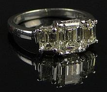 Ladies Approx. 1.51 Carat Emerald Cut Diamond and Platinum Engagement Ring Accented with Two (2) Emerald Cut Diamonds Totally 1.09 Carats. Diamonds K-L Clarity. Signed. Plat 950. Good Condition or Better. Ring Size 6-1/2. Approx. weight: 7 Grams.
