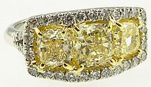 Ladies Very Fine Approx. 3.30 Carat Cushion Cut Fancy Intense Yellow Diamond, Platinum and 18 Karat Yellow Gold Three (3) Stone Ring accented with approx. .75 Carat Round Brilliant Cut Diamonds. Fancy Intense Yellow Diamonds VS Clarity, Round