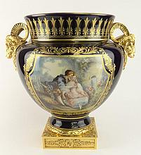 Contemporary ACF Décor de Sevres fait a la main Large Gilt Bronze Mounted Cobalt Porcelain Urn with Rams Head Handles. Signed. Good Condition or Better. Measures 14-5/8 Inches tall and 15 Inches Wide. Shipping $125.00