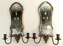 Pair of Antique Two (2) Light Mirrored and Brass Sconces. Each with a Floral Motif. Unsigned. Good Antique Condition. Measures 17 Inches Length, 10-3/4 Inches Width. Shipping $87.00