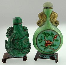 Chinese Carved Malachite Snuff Bottle Together with a Chines Enamel Snuff Bottle with Celadon Jade Stopper, each with wood stand. Unsigned. Cracks to Enamel Otherwise Good Condition. Enamel Bottle Measures 3-1/4 Inches Tall and 2 Inches Wide.