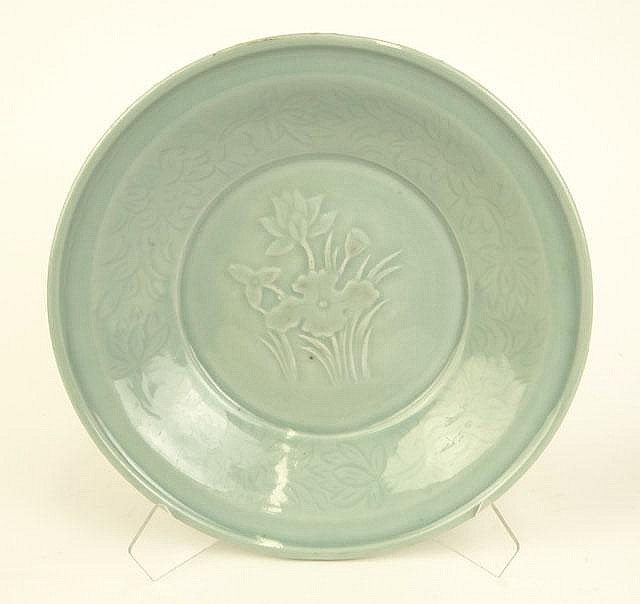 Chinese Celadon Glaze Porcelain Shallow Bowl with Raised Water Lily Decoration. Unsigned. Good to Very Good Condition. Measures 2-5/8 Inches Tall and 12 Inches Diameter. Shipping $42.00