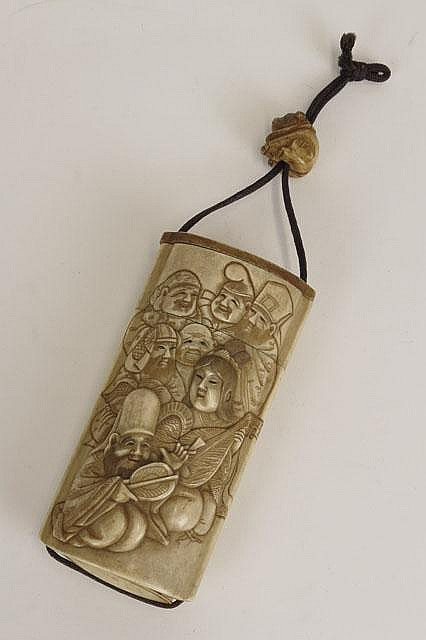 19/20th Century Japanese Carved Bone Inro and Ojime with Well Carved Front Panel in Relief. Unsigned. Good to Very Good Condition. Measures 4-1/4 Inches Long and 2 Inches Wide. Shipping $20.00