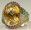 Lady's Large Levian Oval Cut Citrine, Micro Pave Set Multi Stone and 14 Karat White Gold Cocktail Ring. Citrine Measures Approx. 15mm by 11mm. Signed. Good Condition or Better. Ring Size 9. Approx. Weight: 6.85 Pennyweights. Shipping $26.00