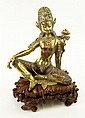 19th Century Sino-Tibetan Heavy Gilt Bronze Seated Buddha with Lotus Flower, Traces of Pigment and with Later Carved Wood Base. Unsigned. Rubbing to Surface Otherwise Good Condition. Measures 10-1/4 Inches Tall and 9-1/2 Inches Wide. Shipping $98.00