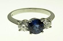 Tiffany & Co 1.4 Carat Oval Cut Sapphire, .90 Carat Round Cut Diamond and Platinum Ring. Signed. Very Good Condition. Ring Size  Approx. Weight:  Shipping $28.00
