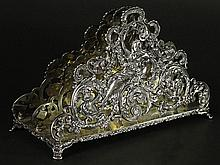 Antique Black Starr & Frost Sterling Silver Letter Holder. Ornate Figural Rococo Style. Signed on Bottom Black Starr & Frost Sterling. Monogrammed A.K.R 1911. Measures 5-1/2 Inches Tall, 8-1/4 Inches Length, 3-3/4 Inches Width and Weighs 24.82 Troy