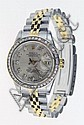 18 Karat Yellow Gold and Stainless Steel Ladies Rolex Datejust Wrist Watch with after Market Diamond Bezel, Diamond Hour Markers and with Date Indicator. Serial Number 9772117. Signed. Has Original Box. Good Working Order. Shipping $25.00