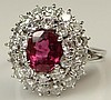 Lady's Antique style 1.41 Carat Oval Cut Ruby, 1.5 Carat Round Brilliant Cut Diamond and 18 Carat White Gold Ring. Ruby with Vivid Saturation of Color, Diamonds F-G Color, VS2- SI1 Clarity. Ring Size 6. Approx Weight: 3.80 Pennyweights. Shipping