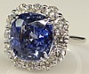 Important 9.12 Carat Cushion Cut Sapphire, 1.95 Carat Round Brilliant Cut Diamond and 18 Karat White Gold Ring. Sapphire with Medium Blue Saturation of Color, VS Clarity. Diamonds E-F Color, VS Clarity. Unsigned. Good Condition or Better. Ring Size
