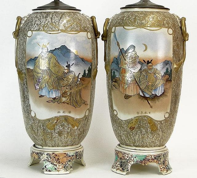 Large Pair of Early 20th Century Japanese Satsuma Vases with Mock Ring Handles Mounted as Lamps with Porcelain Bases. Signed on Reserve Panels. Drilled, Flaking to Gilt Decoration, Craquelure and Damage to One Lamp Stem Otherwise Good Condition.