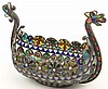 Plique-A-Jour Enamel and Silver Boat in the Form of a Viking Ship. Decorated in Multi-Color Translucent Enamel Floral and Geometric Patterns. Stamped 950 and Makers Mark. The White Jeweling Surrounding the Vessel Has some small Cracks and one (1) of