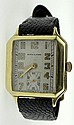Art Deco Man's Hamilton Fourteen Karat Yellow Gold Tank Watch with Fourteen Karat Gold Buckle and Leather Strap. Signed. Monogrammed to Back of Case, Surface Wear from Normal Use, Running Condition, Worn Strap. Case Measures 1-5/8 Inches by 1-1/8