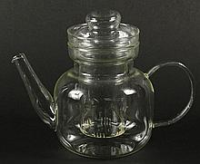 Vintage Schott Mainz Jenaer Germany Glass Tea Pot. Has Inner Glass Diffuser and Lid. Measures 9-1/2 Inches From Spout to Handle, 4-3/4 Inches Diameter and 7-1/2 Inches Tall. Shipping $42.00 (estimate $50-$100)