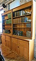 Built in American oak bookcase with base cabinet door