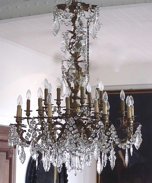 AN IMPRESSIVE FRENCH GILT BRONZE AND CRYSTAL TWENTYFOUR BRANCH CHANDELIER