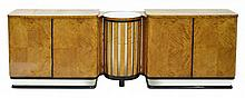 AN ART DECO BLONDE WOOD TWO SECTIONAL SIDEBOARD, WITH A CENTRAL REVOLVING COCKTAIL CABINET