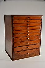 AN ANTIQUE PINE COLLECTOR'S CABINET
