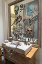 A LARGE TIMBER FRAMED MIRROR PAINTED WITH SKULLS AND BUTTERFLIES BY DAVID BROMLEY
