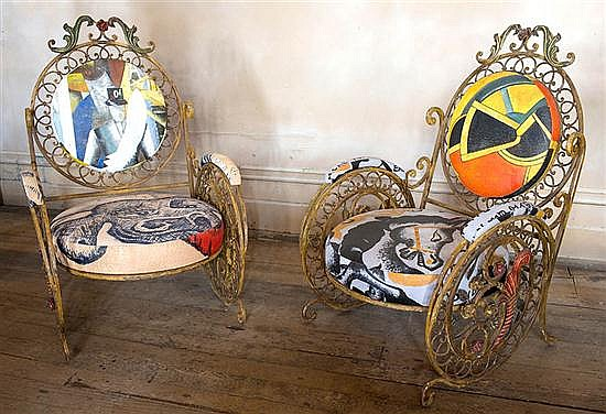A PAIR OF DECORATIVE WROUGHT IRON SUN CHAIRS WITH HAND-PAINTED UPHOLSTERY BY DAVID BROMLEY