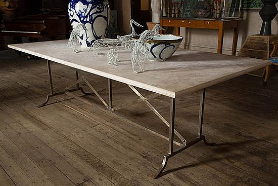 A TRAVERTINE TOP TABLE ON WROUGHT IRON BASE