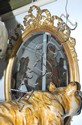 A OVAL GILT WOOD WALL MIRROR