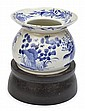 A CHINESE BLUE AND WHITE PORCELAIN SPITTOON ON STAND