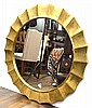 A CIRCULAR WALL MIRROR WITH BEATEN GILT METAL SURROUND,120 CM DIAMETER