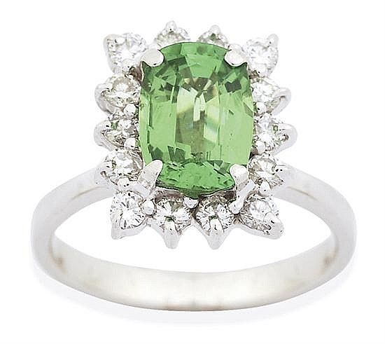 A TSAVORITE GARNET AND DIAMOND RING