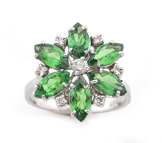 A TSAVORITE GARNET AND DIAMOND CLUSTER RING