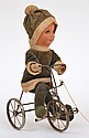 PULL ALONG COMPOSITE HEAD DOLL WITH SOFT BODY RIDING A TRICYCLE