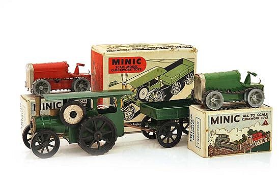 TWO TRIANG MINIC TRACTORS, ONE GREEN ONE RED, ONE KEY MISSING; AND TRACTION ENGINE AND TRAILER, IN ILLUSTRATED BOXES (VG-E BOXES G)....