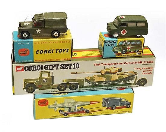 FOUR CORGI MILITARY MODELS INCLUDING 414 BEDFORD MILITARY AMBULANCE; 500 U.S. ARMY LAND ROVER, RED INTERIOR; AND GS10 TANK TRANSPORT...