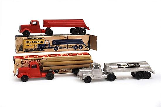 THREE TOOTSIETOY COMMERCIAL VEHICLES INCLUDING 3760 LOGGER; UNION CARBIDE CHEMICALS TANKER UNBOXED; AND 669 OIL TANKER (G-VG BOXES G...