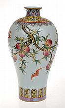 CHINESE PORCELAIN BOTTLE VASE, HEAVILY ENAMELLED FAMILLE ROSE WITH PEACH AND BAT DECORATION, SIX CHARACTER PSEUDO KANGXI MARK TO BASE, 20TH CENTURY, 26CM HIGH